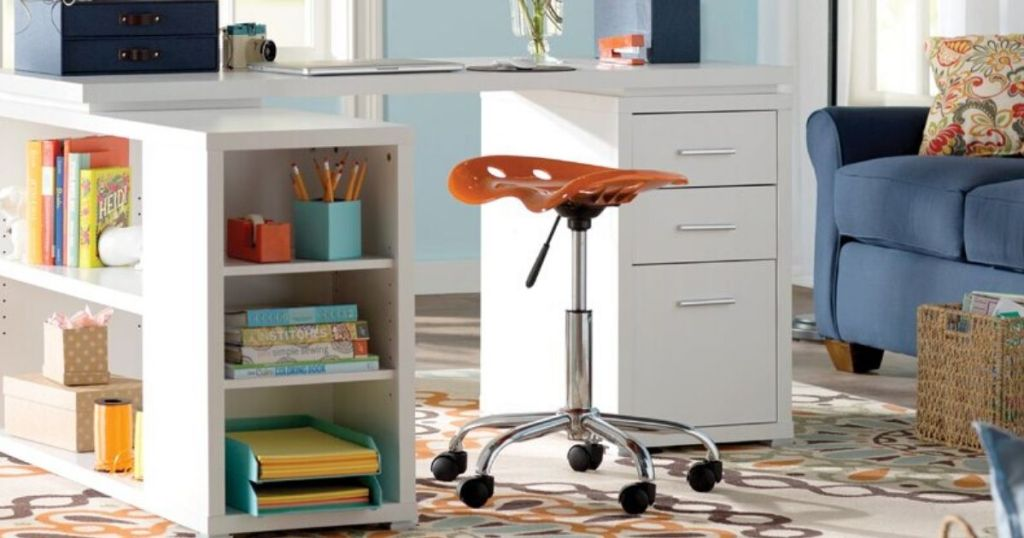desk with rolling stool next to it