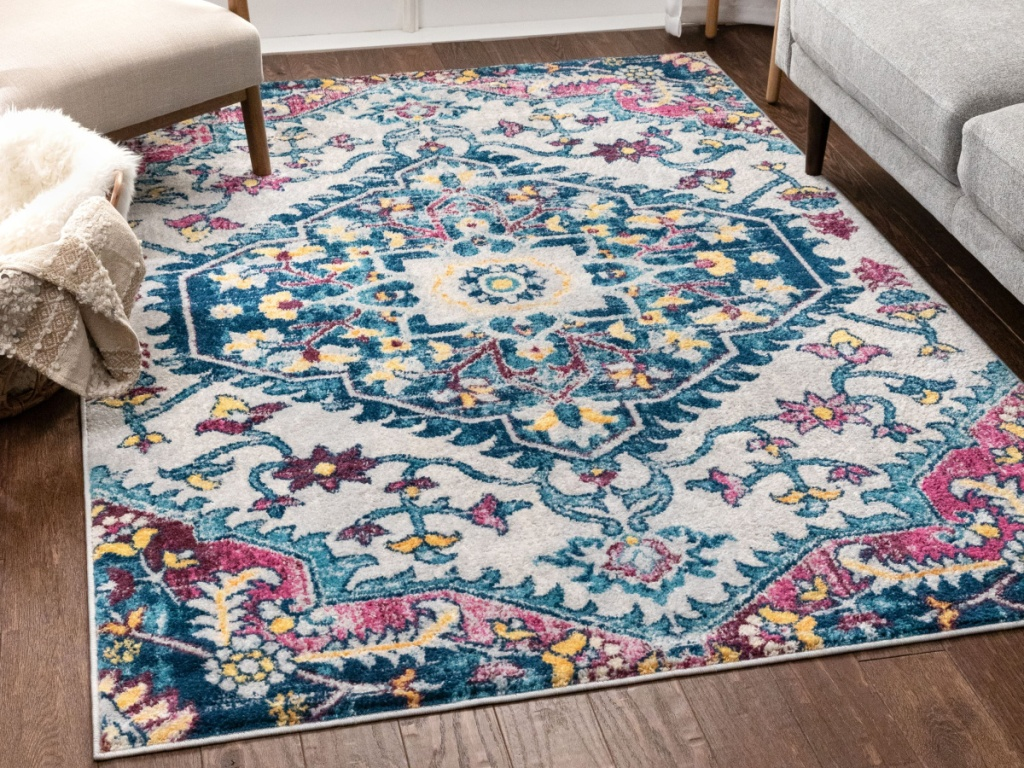 blue floral area rug on floor in home