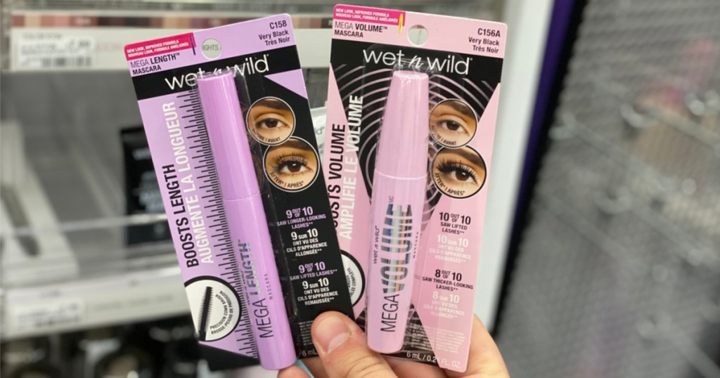 hand holding two packaged mascaras in store