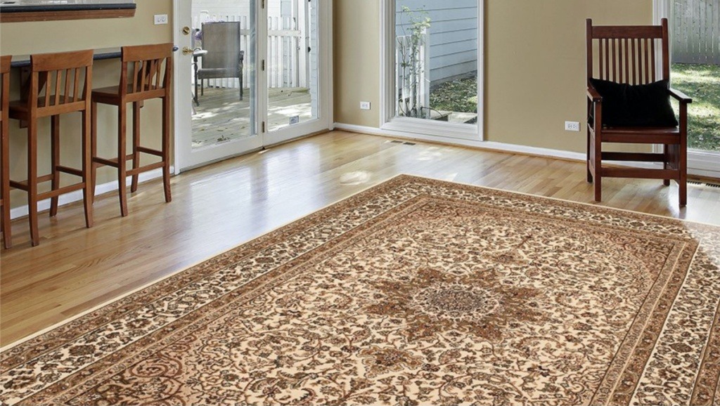 tan area rug on floor in home
