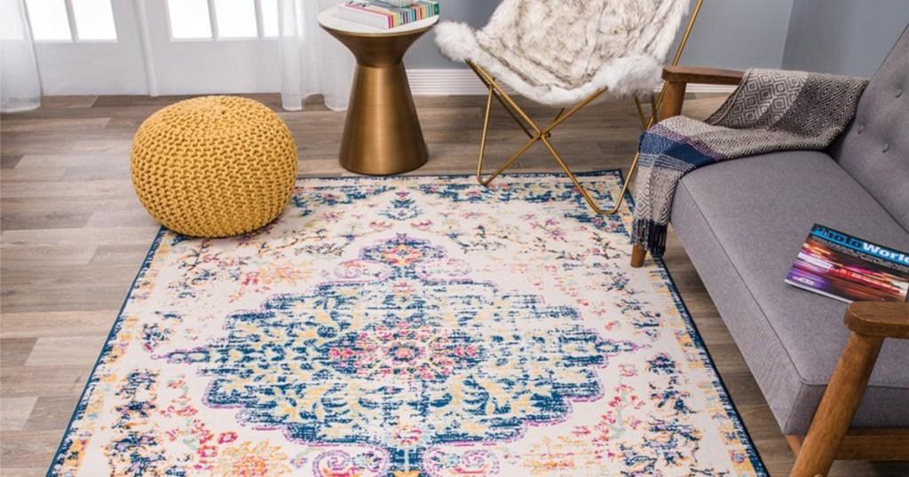 dark blue multi-colored bohemian area rug on floor in living room