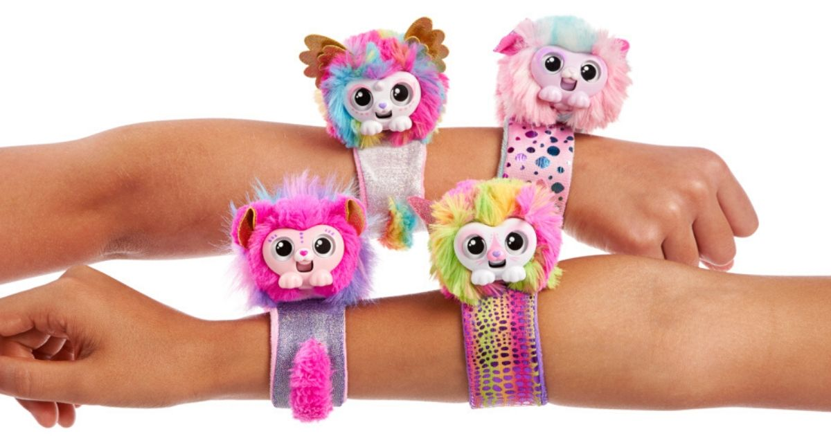 colorful furry animal bracelets being worn on two arms