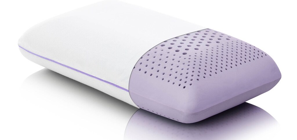 purple pillow with half of a pillowcase on it
