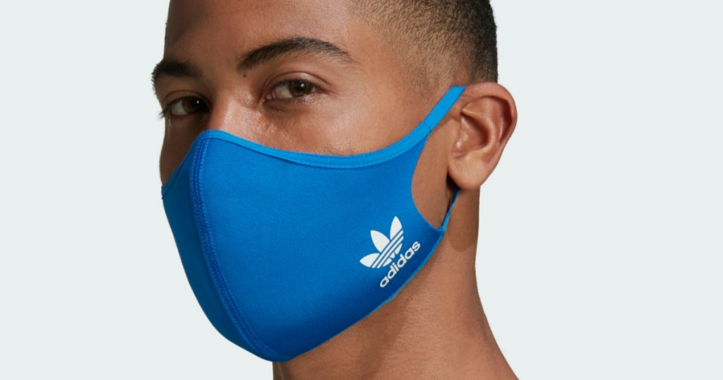 man wearing an adidas face mask