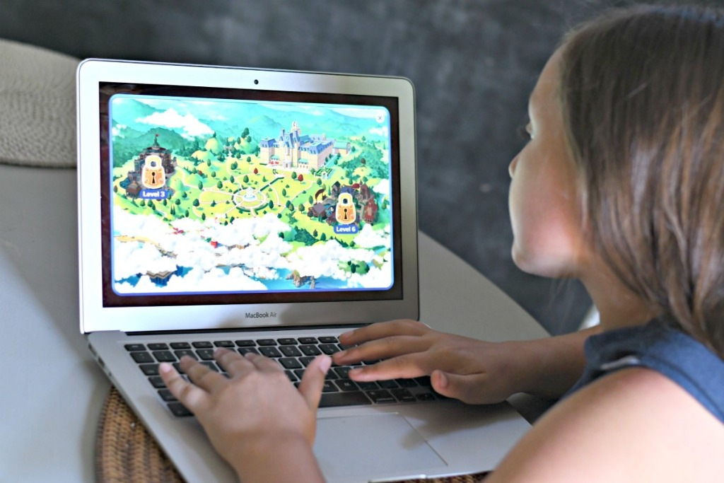 girl playing Adventure Academy on a computer