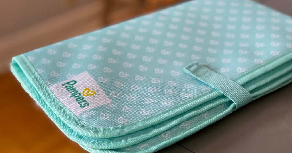 blue and white pampers portable changing pad