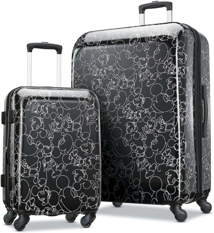 stock image of two pieces of luggage with black and white mickey mouse designs