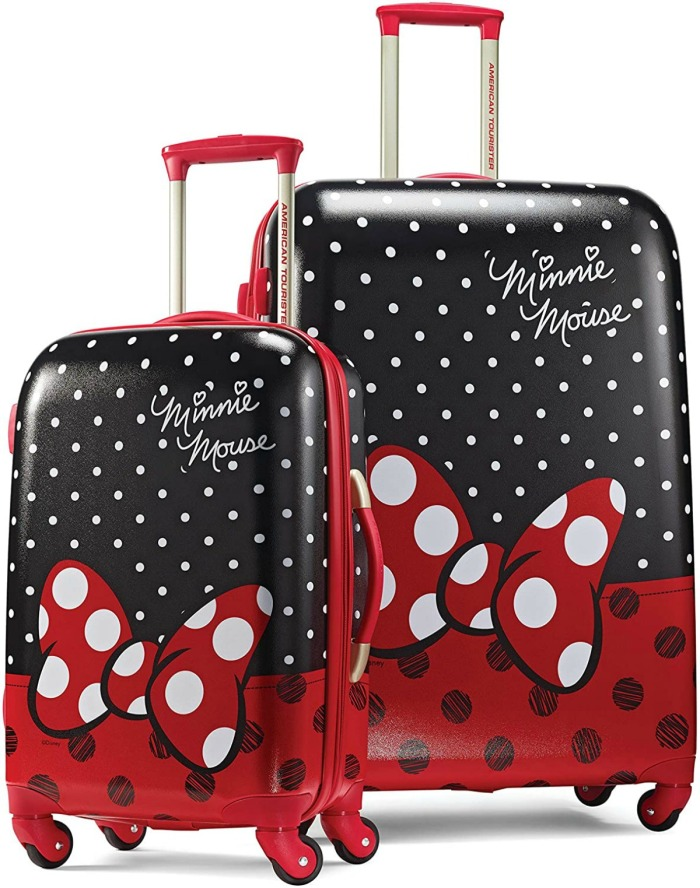 stock image of two pieces of luggage with minnie mouse's red bow
