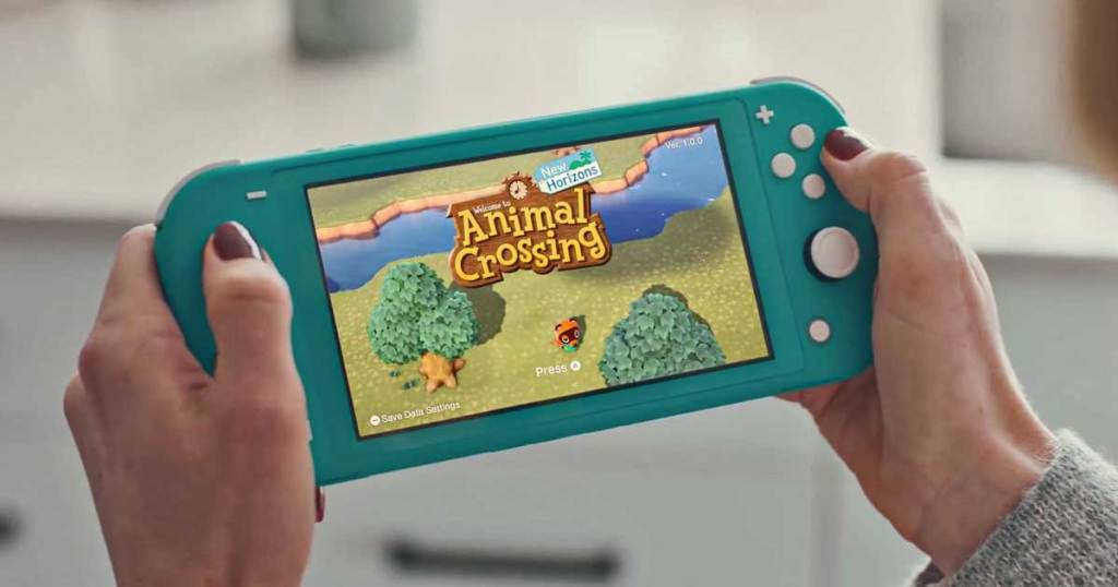 woman holding nintendo switch playing animal crossing