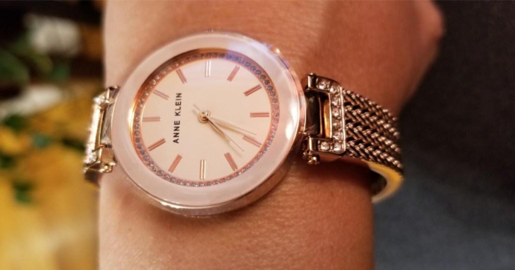 womens wrist wearing anne klein rose gold watch watch