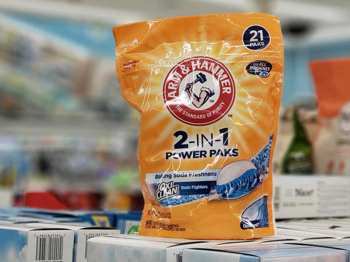 bag of arm & hammer laundry pacs sitting on packages on a store shelf