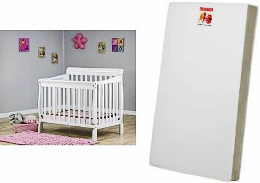 baby crib in nursery and a baby crib mattress