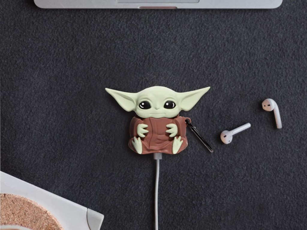 Baby Yoda Airpods case plugged into charger