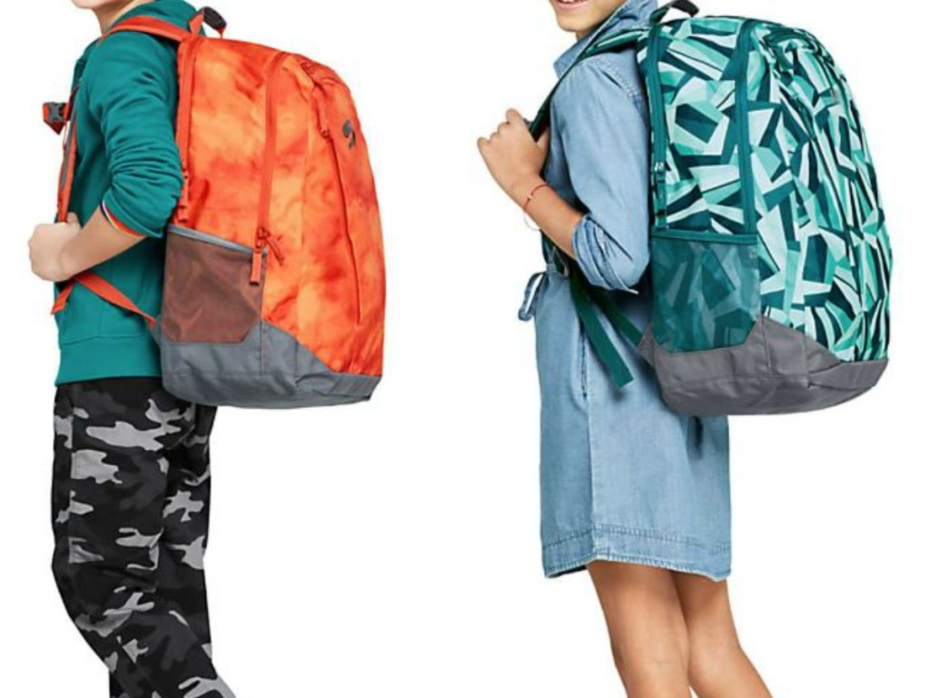 2 kids with colorful backpacks on
