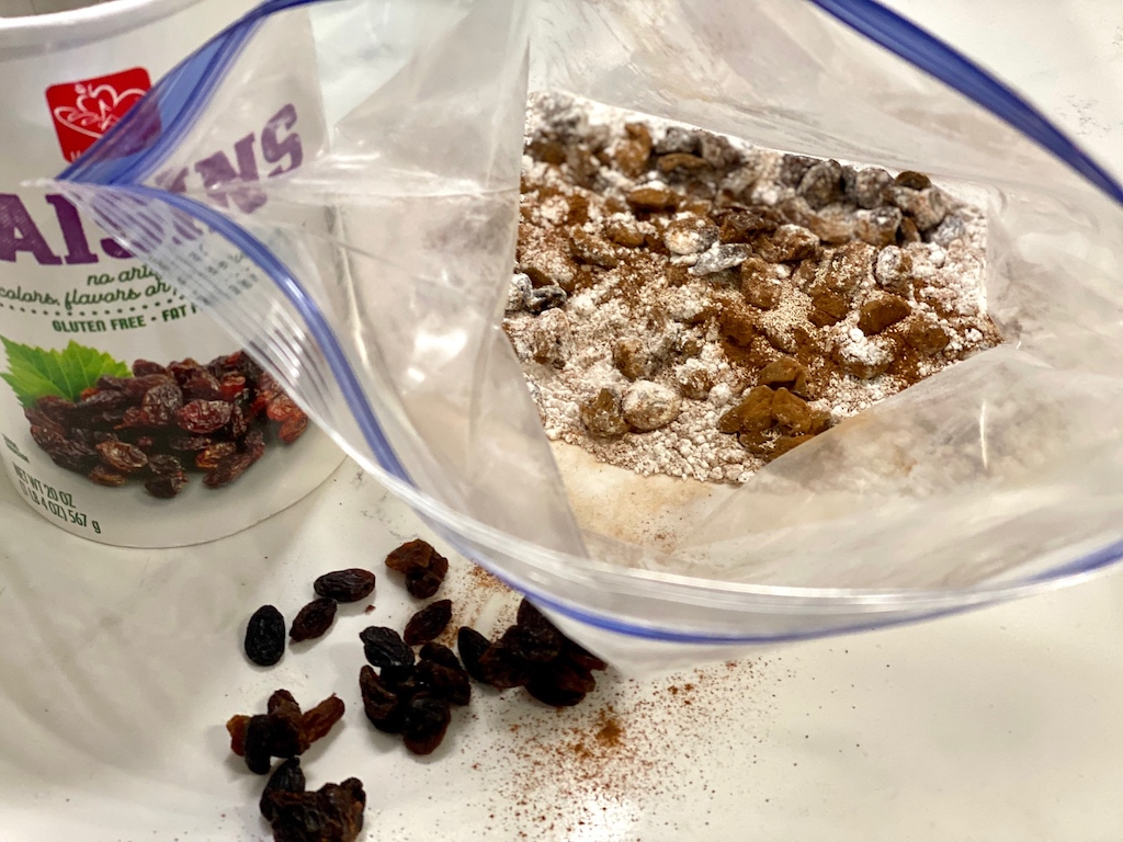cinnamon, raisins and flour in ziploc bag