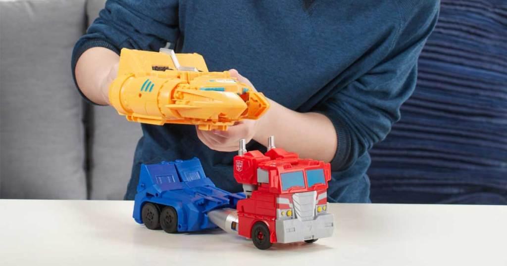 boy playing with optimus prime transformer