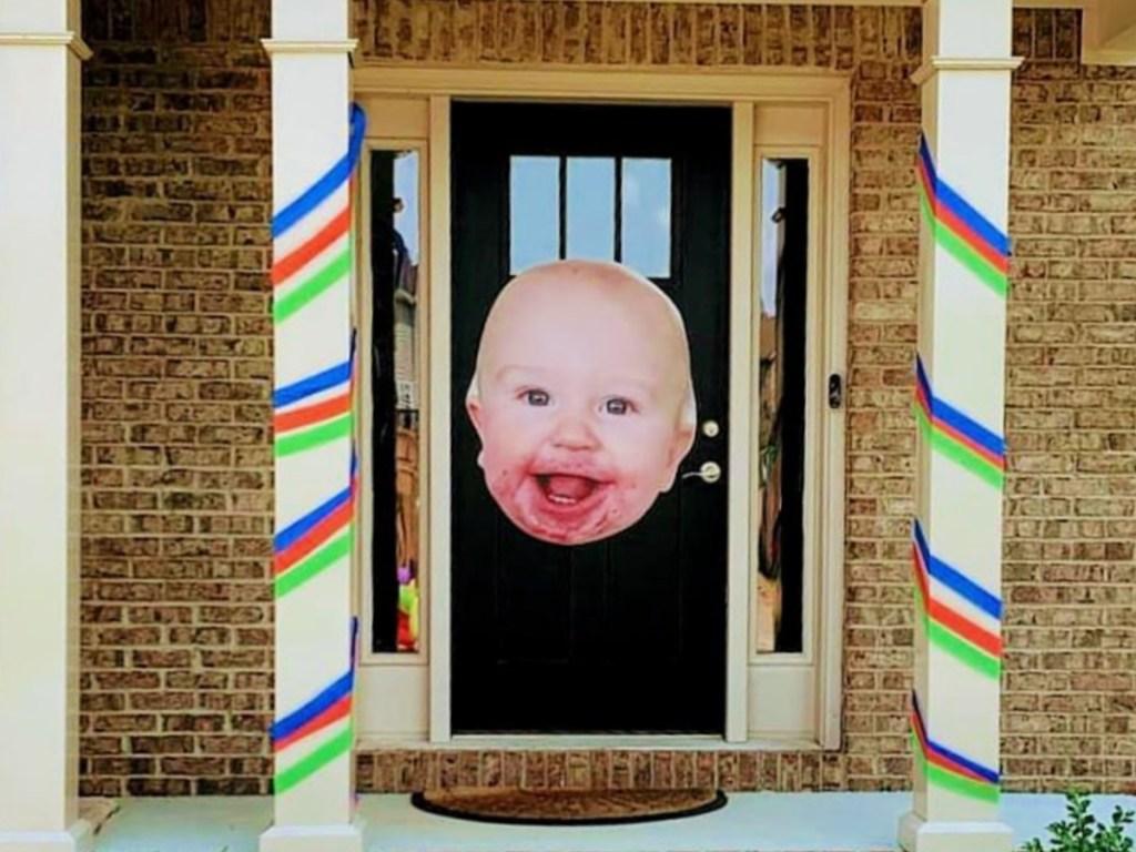 bigheads cutout of baby on door