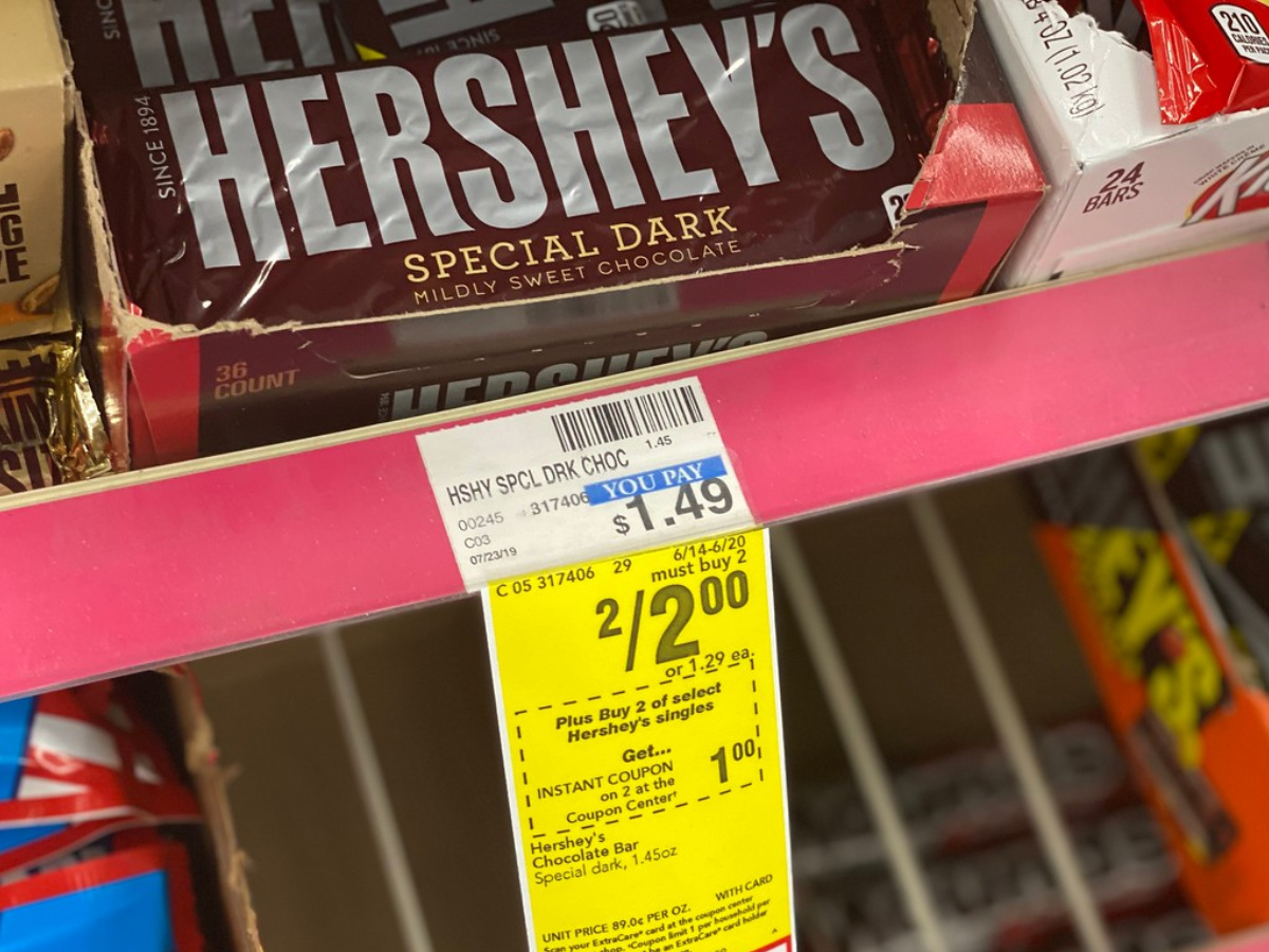 candy bar in box on store shelf near price tag