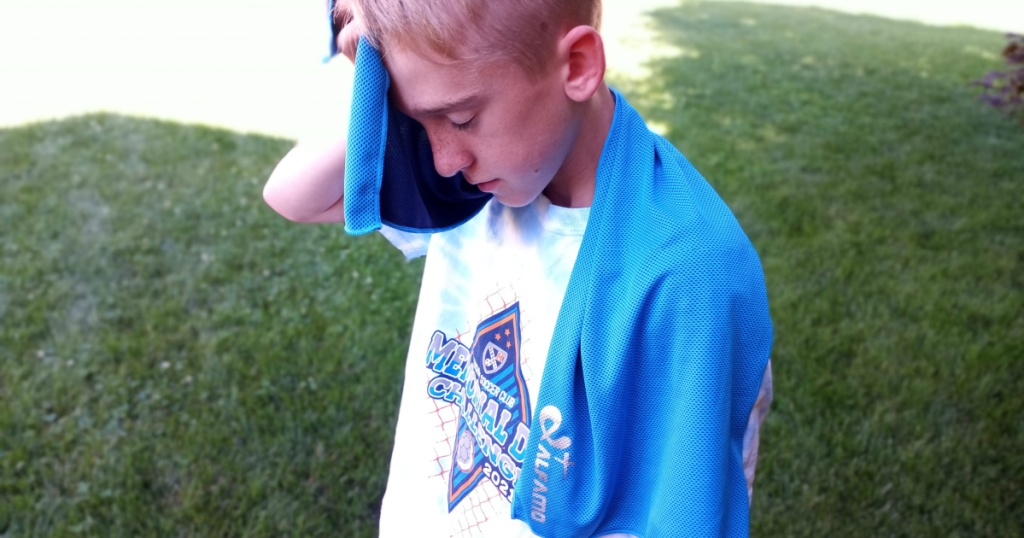 boy using amazon cooling towel