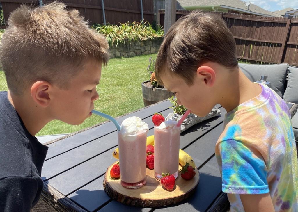 boys drinking smoothie