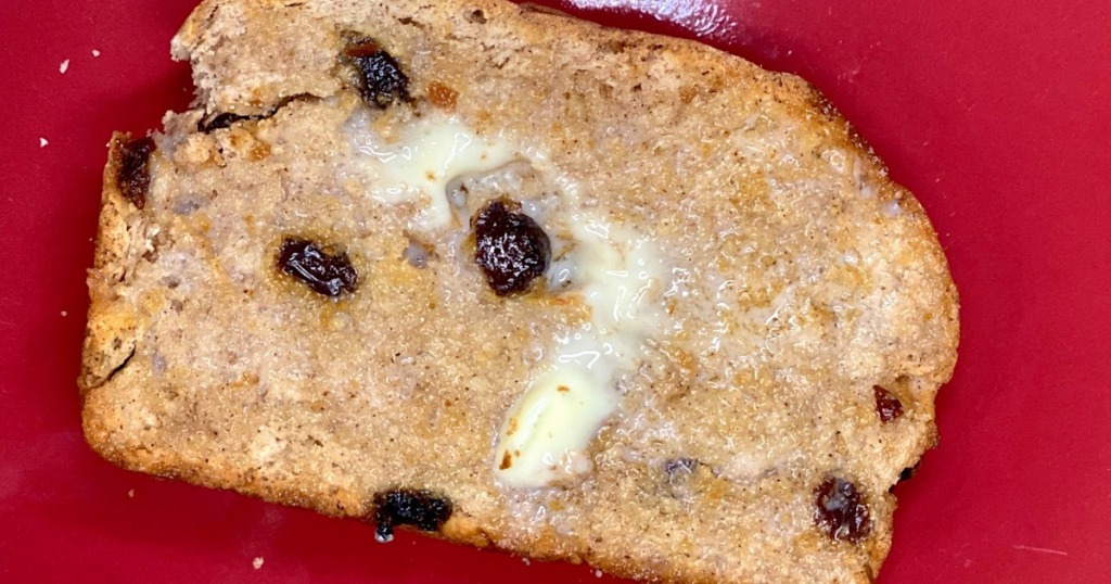 raisin cinnamon bread slice with butter slathered on top