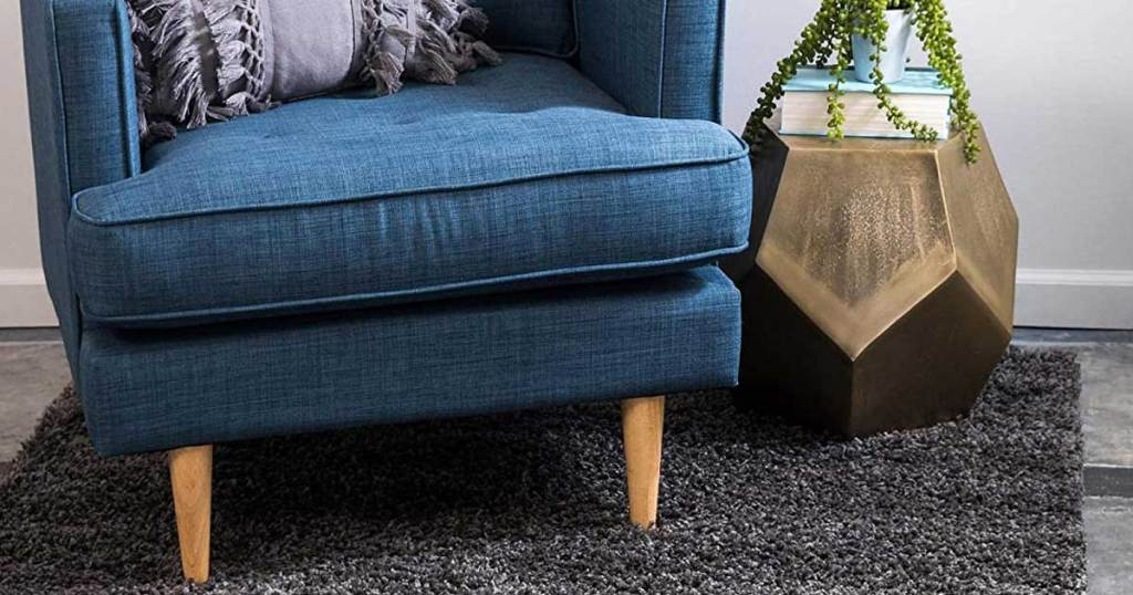 blue chair with a gray rug