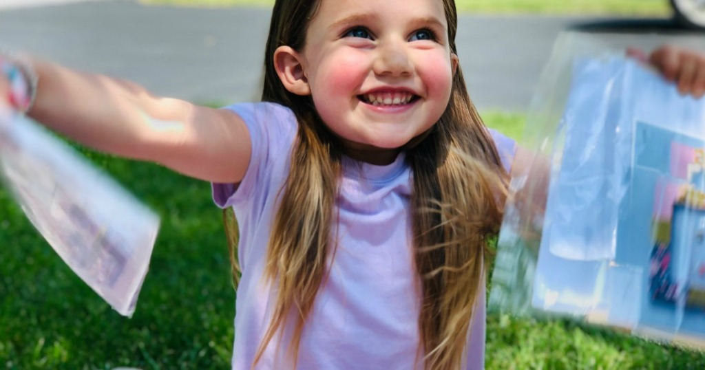 little girl excited about virtual summer camp