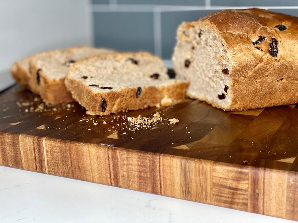 sliced cinnamon raisin bread on cutting board
