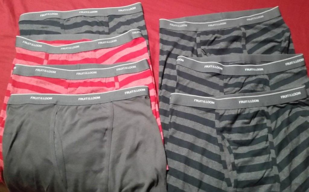 7 pairs of boxer shorts laid out on red background