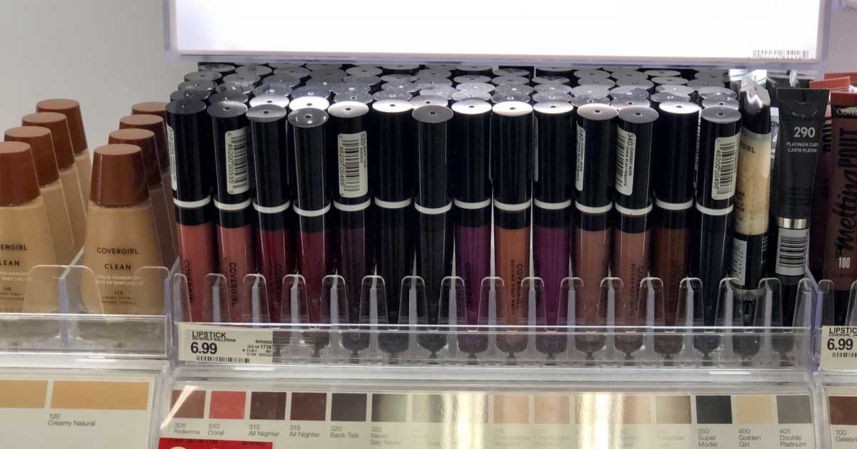 rows of lipstick on display in store