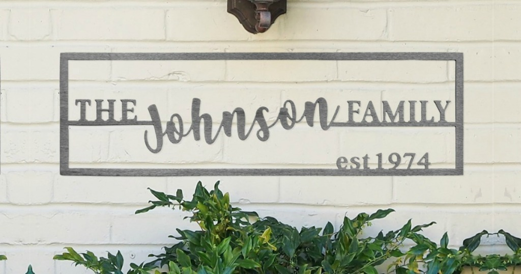 custom steel family name sign hanging on wall