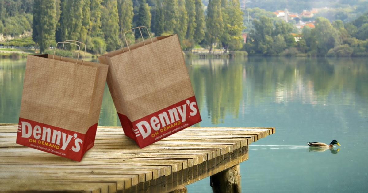 2 denny's bags on dock in front of pond