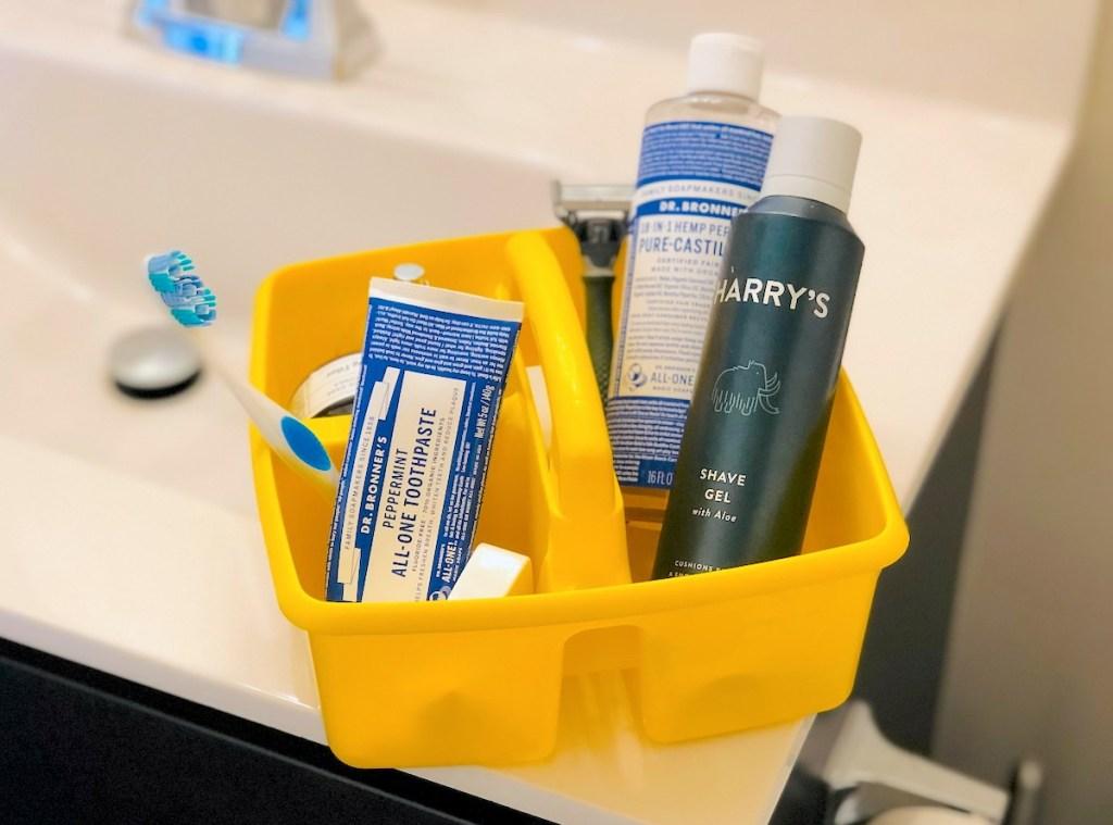 yellow classroom caddy on bathroom sink with bathroom essentials for getting ready
