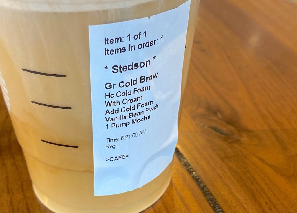 close up of starbucks order sticker on plastic cup