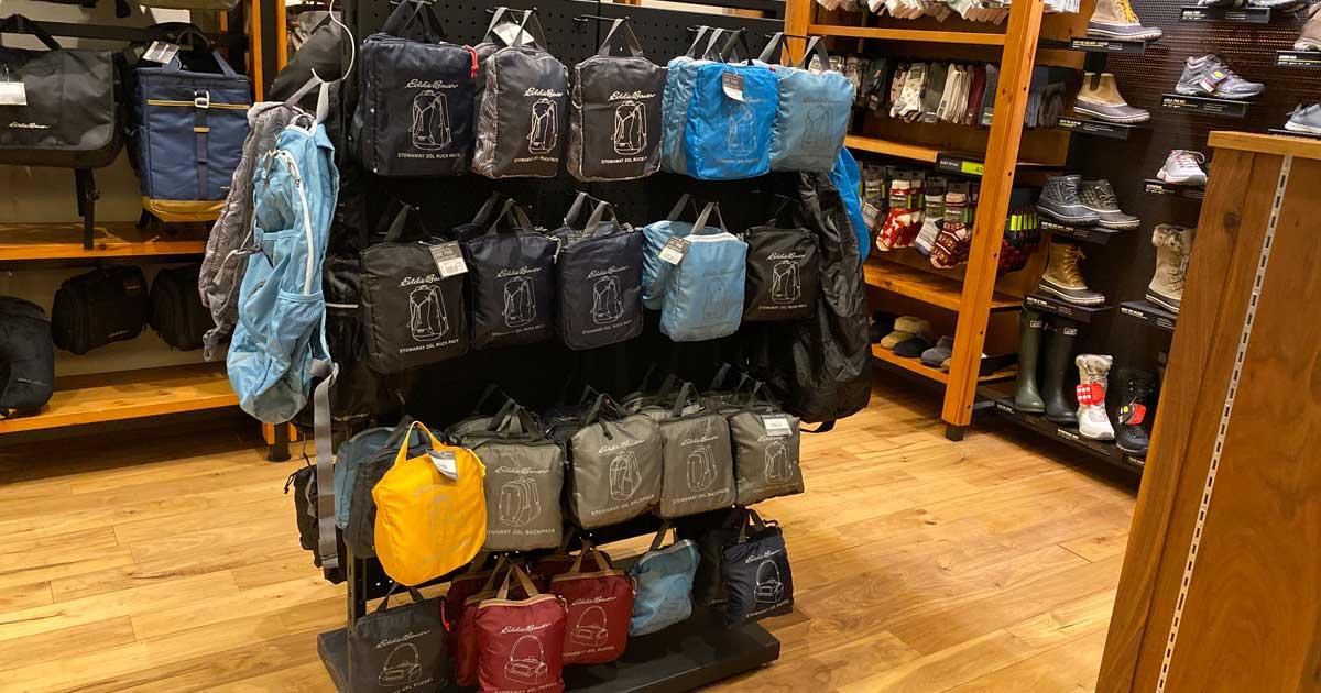 store display full of package daypacks in various colors
