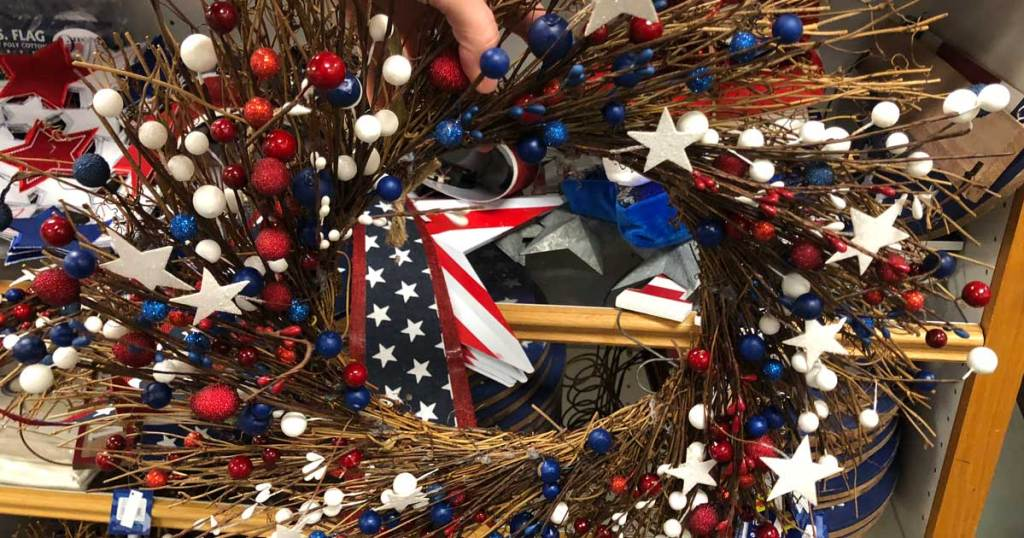 hand holding fourth of july wreath
