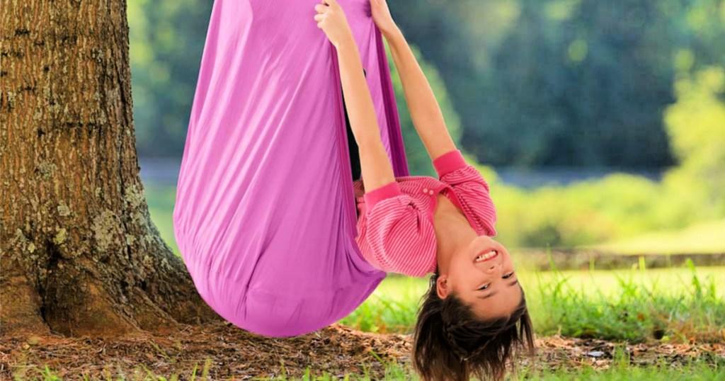 girl swinging in a purple Hearthsong Hugglepod