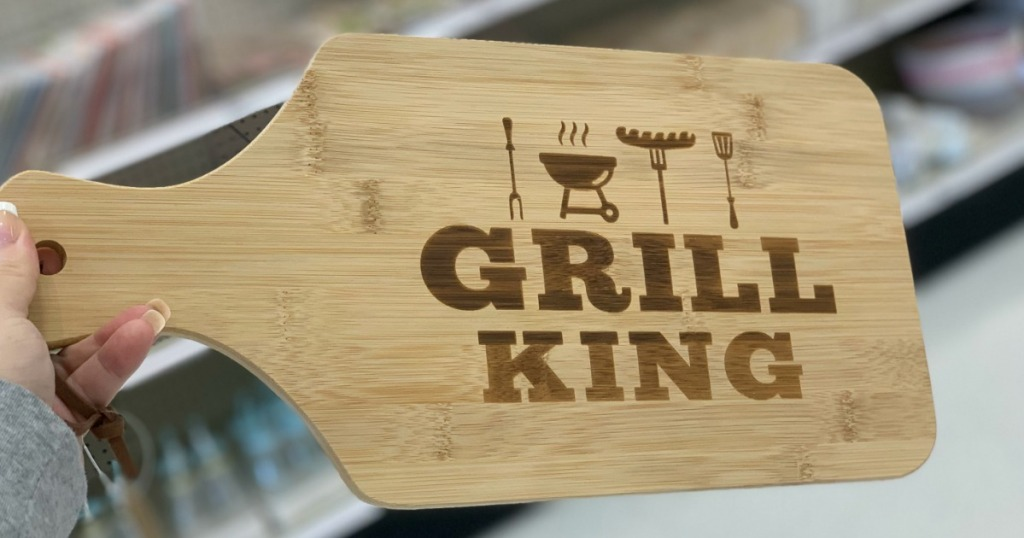 hand holding cutting board by store display