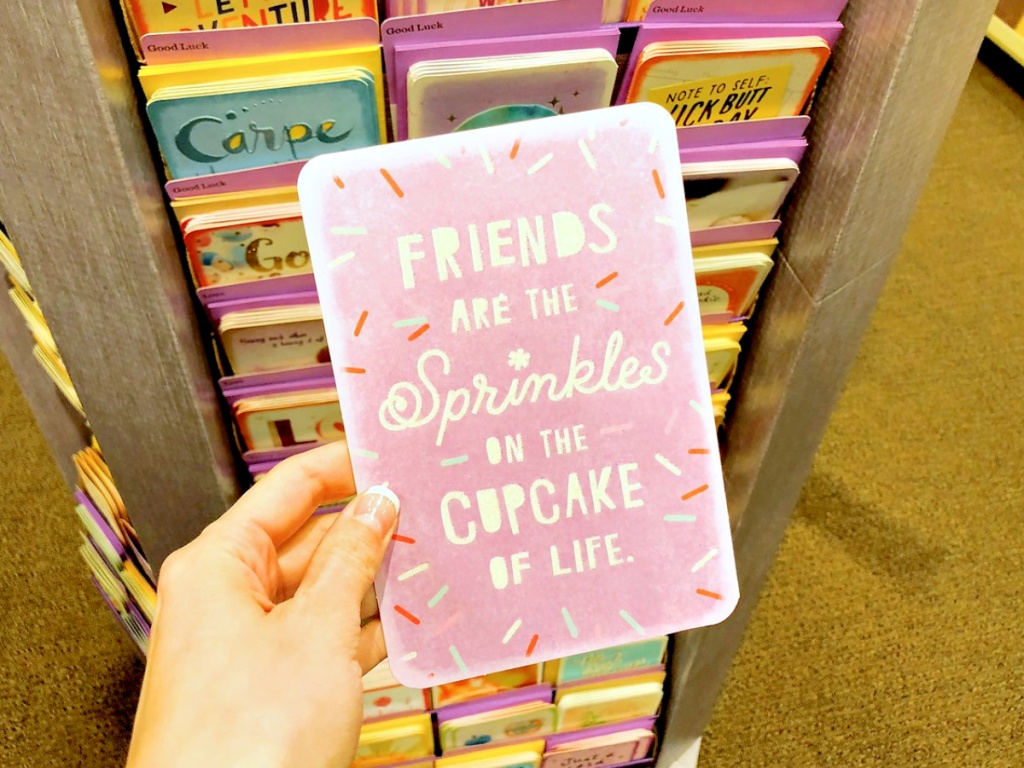 hallmark card in person's hand with sprinkles and thoughtful message