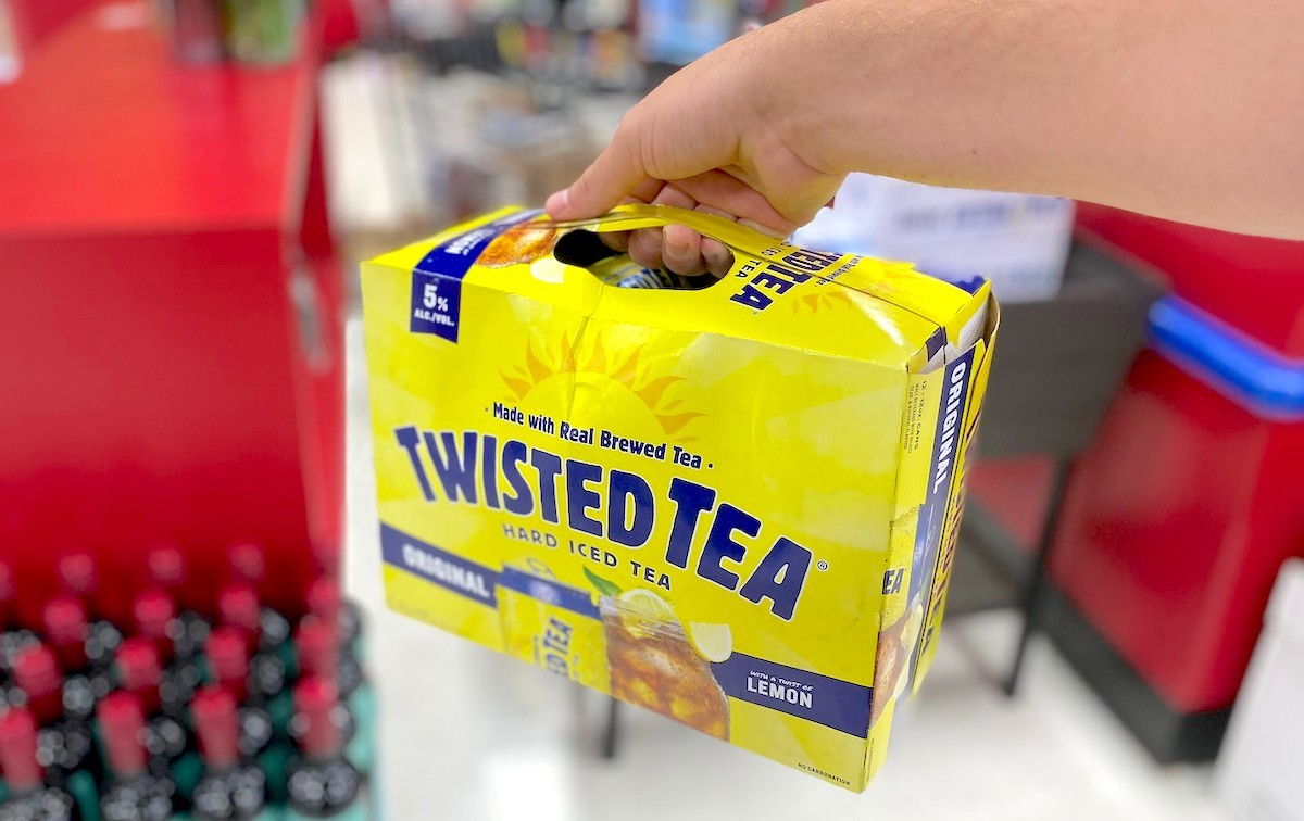 hand holding a box of yellow twisted tea
