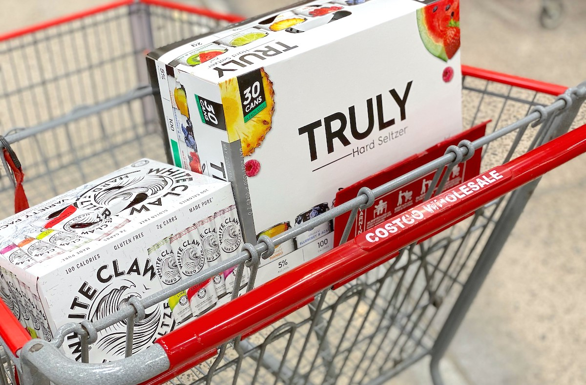 box of white claw and truly hard seltzer drinks in costco cart