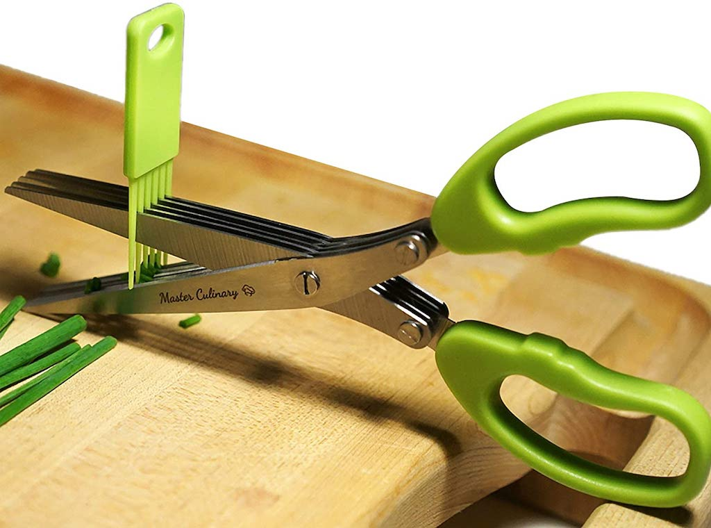 cleaning herb scissors with brush