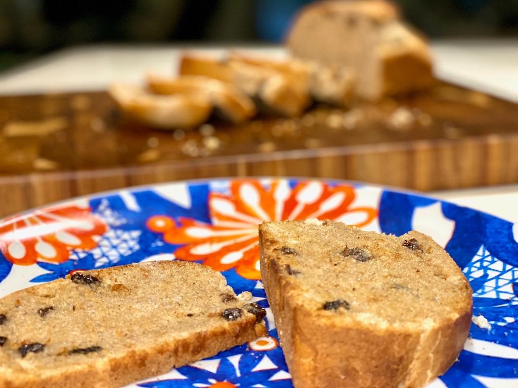 homemade cinnamon raisin bread slices on plate