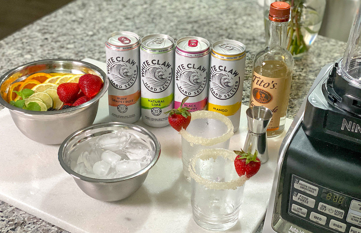 spread of fresh fruit white claw and other ingredients for blending