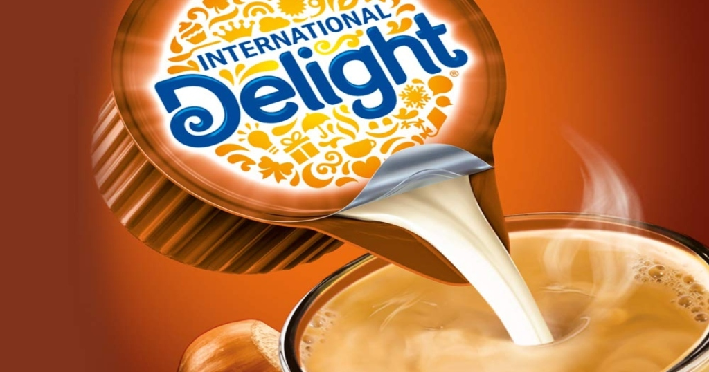 International delight creamer cup, pouring into a cup of coffee
