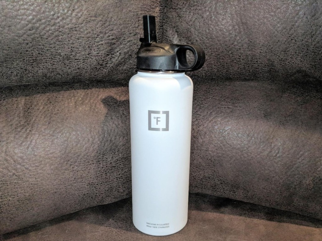white watter bottle on brown leather couch