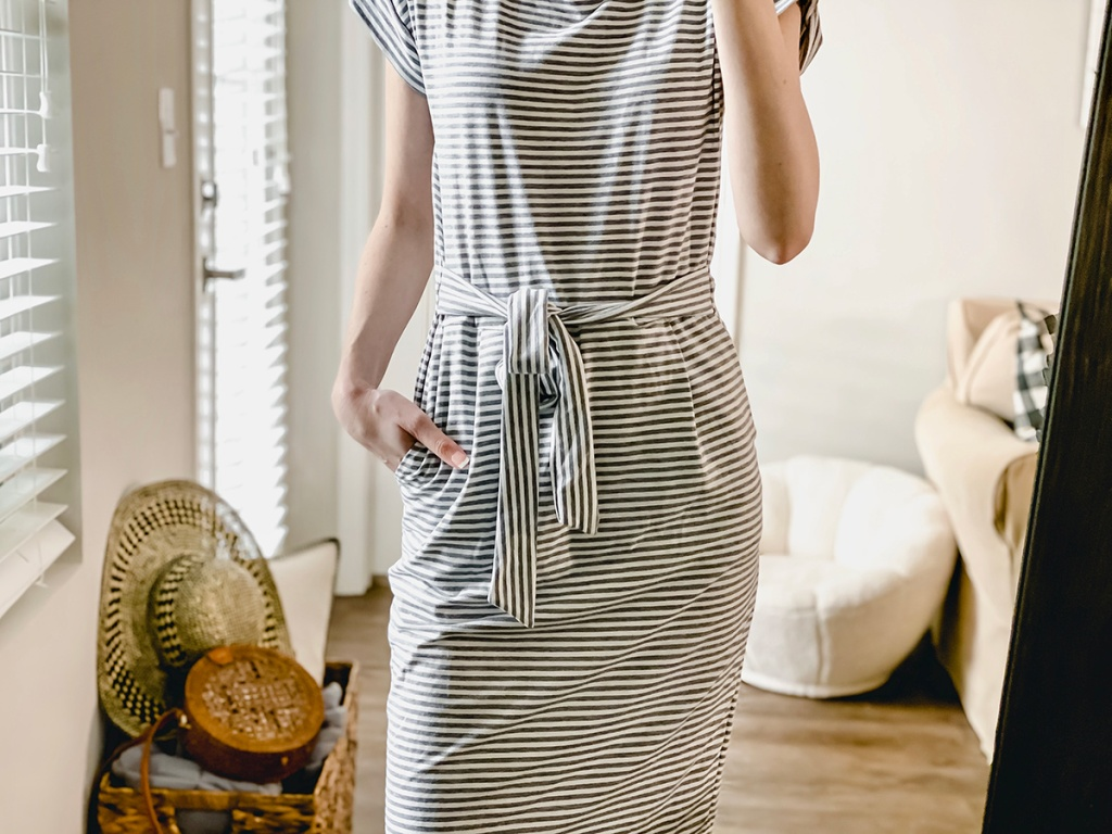 woman wearing white and grey striped dress from amazon
