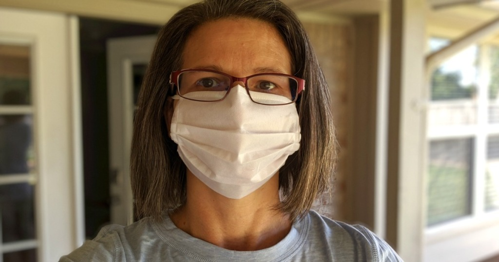 woman wearing disposable face mask
