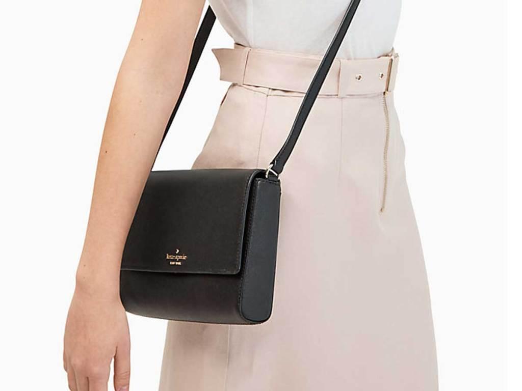 kate spade black crossbody purse on lady
