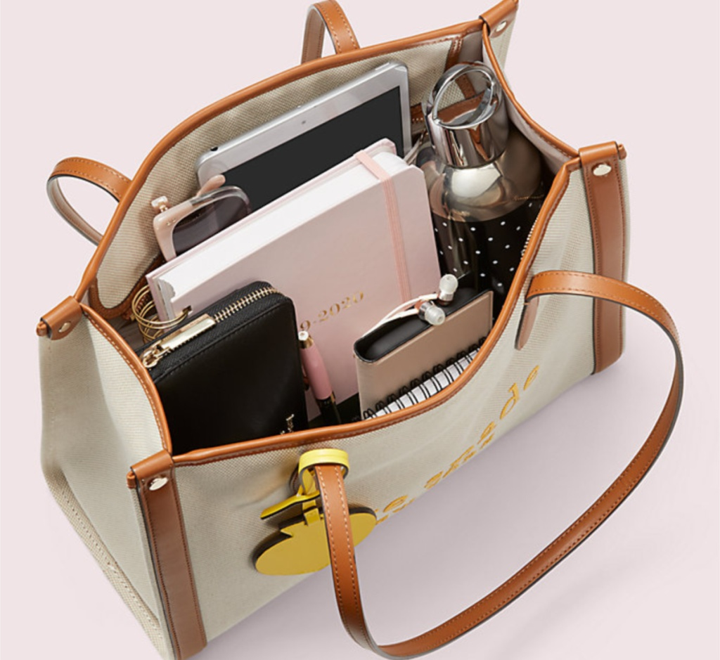 kate spade tote open with stuff inside
